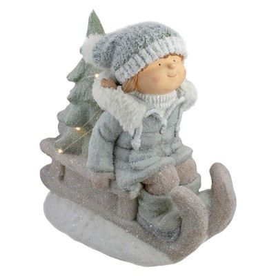 "Northlight 15"" Beige and Green Lighted Girl on a Sled Christmas Decoration"