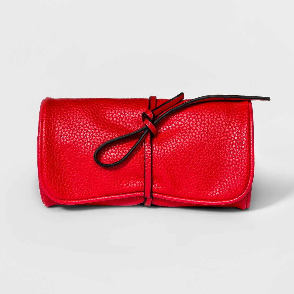 Women's Jewelry Roll with Interior Jewelry Organizer - A New Day Bright Red Pack your jewels in blissful ease with the Jewelry Roll with Interior Jewelry Organizer from A New Day. The zip pockets separate your rings, necklaces and the like to prevent knotted jewelry clusters, while the tie closure keeps your jewelry secure and adds pretty detail. The roll style makes it easy to tuck away in a tote bag or suitcase, allowing you to accessorize as you please wherever you go. Color: Red. Gender: Female.