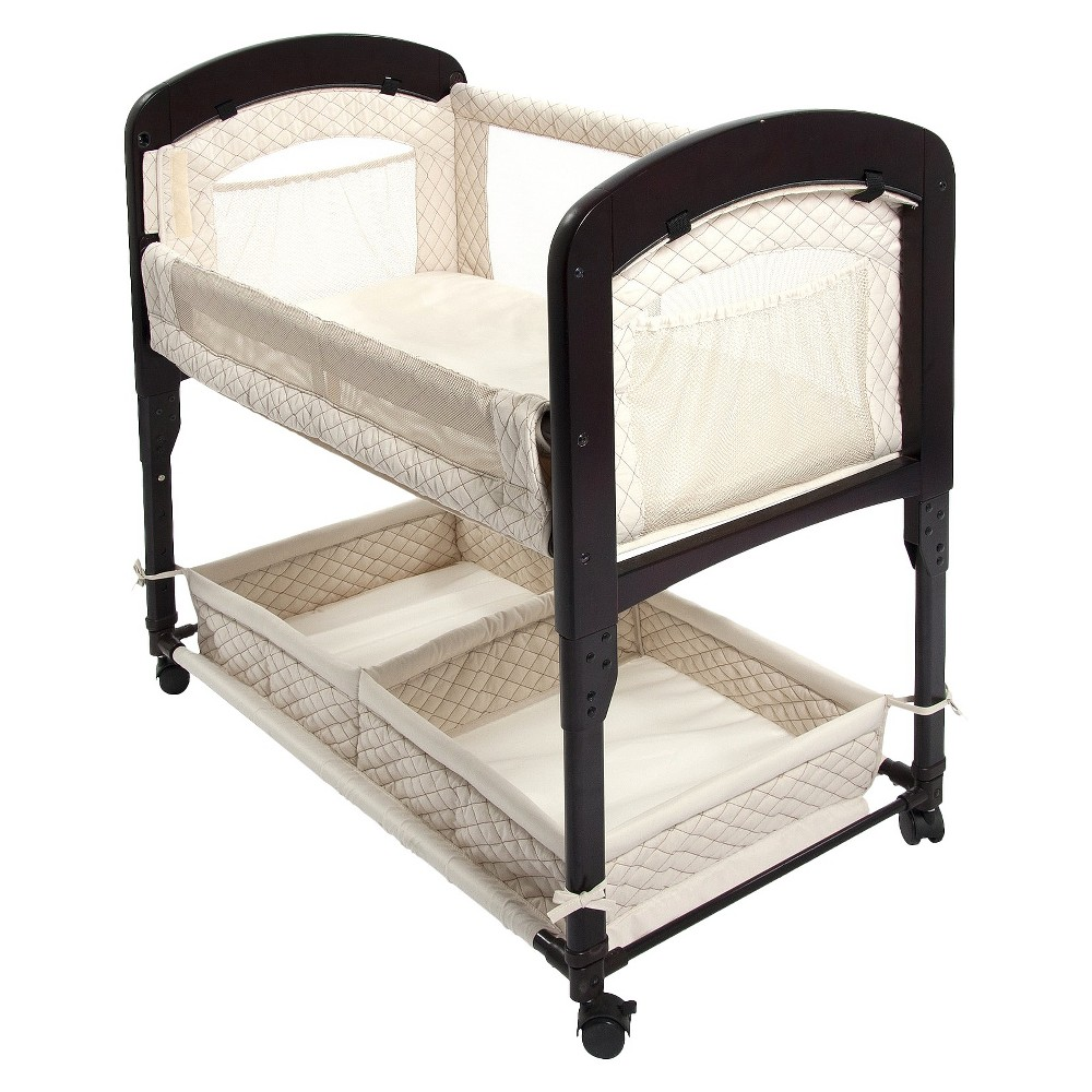 Arm's Reach Cambria Co-Sleeper Bassinet - Natural The Cambria Co-Sleeper bedside bassinet features beautifully curved wooden ends. Like all of our Co-Sleeper bedside bassinets, the Cambria Co-Sleeper bedside bassinet allows you and your baby to sleep comfortably next to each other from the moment your baby arrives. This bedside bassinet enables you to reach over and draw your baby close for comforting and bonding. The innovative design also makes breastfeeding easy. The Cambria Co-Sleeper bassinet is the ideal sleep solution for any concerned parent. The Cambria Co-Sleeper bassinet has two modes, the Co-Sleeper mode, and the freestanding bassinet mode. With a study wood frame, adjustable built in leg extensions and patented attachment strap and plate provide the safest sleep solution for you and your newborn. All Cambria Co-Sleeper bassinets include everything you need to get started- a sheet, a mattress, a nylon attachment strap and plate and removable and washable fabric liner. **For bed heights starting at 24, measured from the floor to the top of the adult mattress. Color: Natural. Gender: Unisex.