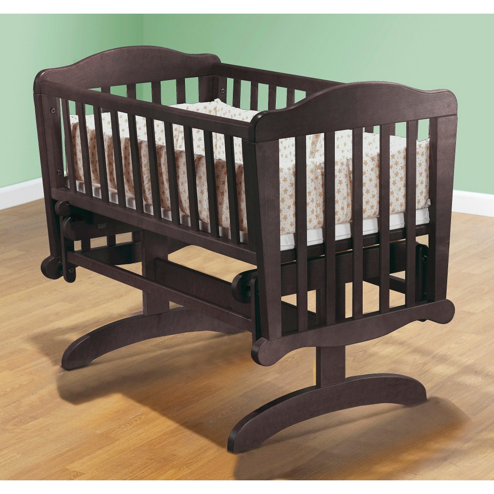 Sorelle Dondola Cradle - Espresso (Brown) Gently glide your baby to sleep in the Dondola Cradle from Sorelle. Cradle mattress included. Solid pine wood construction features smooth, hand rubbed surfaces and corners. Color: Espresso. Gender: Unisex.