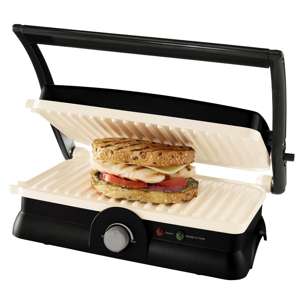 Oster Titanium Infused DuraCeramic Panini Maker & Grill - CKSTPM20W-Teco, Black This Panini Maker and Grill is designed with unique, innovative Titanium Infused DuraCeramic non - stick ceramic coating to last 8 times longer than ordinary non - stick surfaces. This extra - durable, super - hard surface won't flake or peel. Natural Titanium Infused DuraCeramic; is Pfoa and Ptfe free and cooks up to 30 percent faster to save time and energy. 2 - in - 1 panini maker and grill can be used for versatile, easy and convenient countertop cooking. With the Oster brand, you can cook with passion and serve with pleasure. Color: Black.