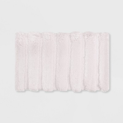 "21""x34"" Tufted Pearl Channel Solid Bath Rug Blush"