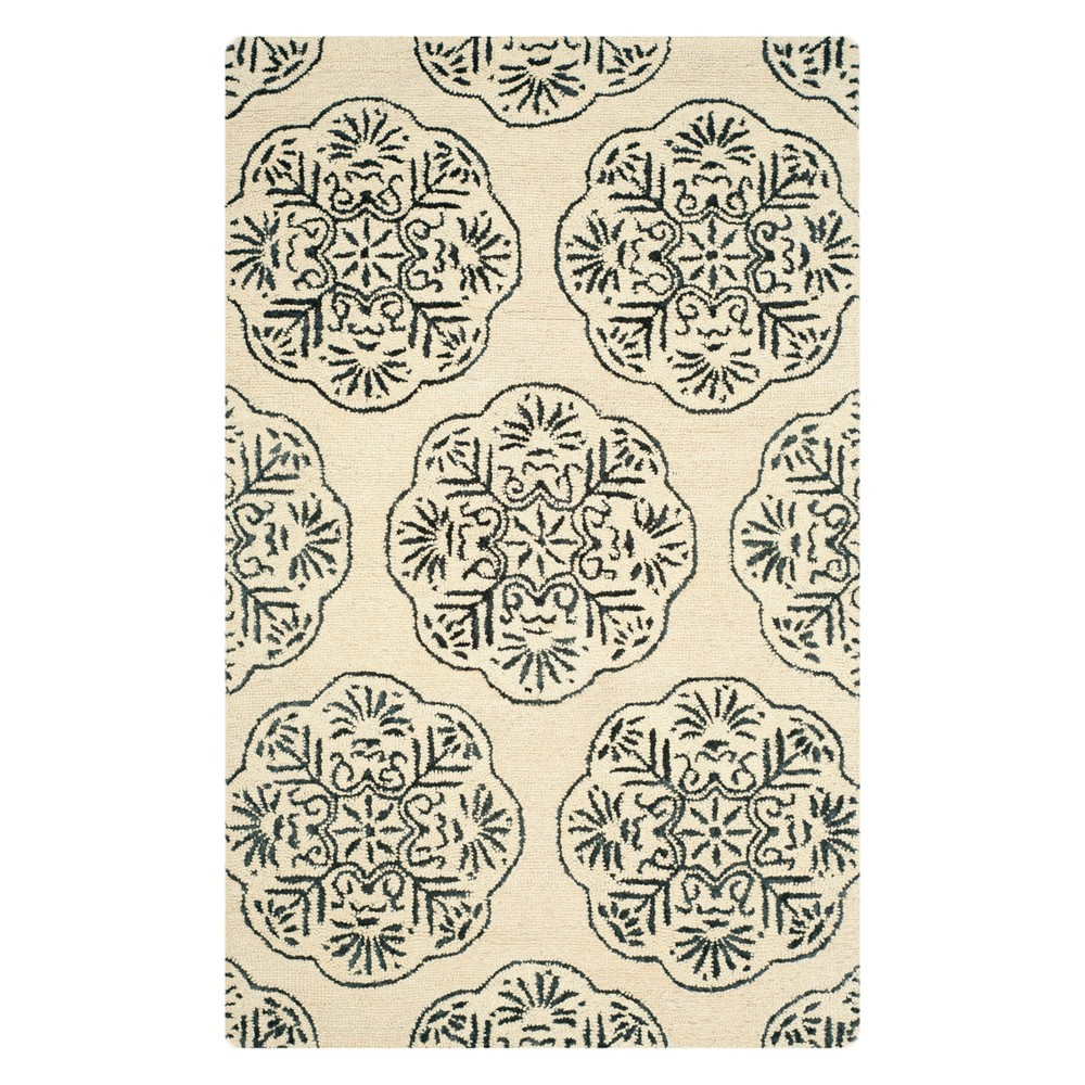 5'X8' Medallion Area Rug Ivory/Charcoal (Ivory/Grey) - Safavieh