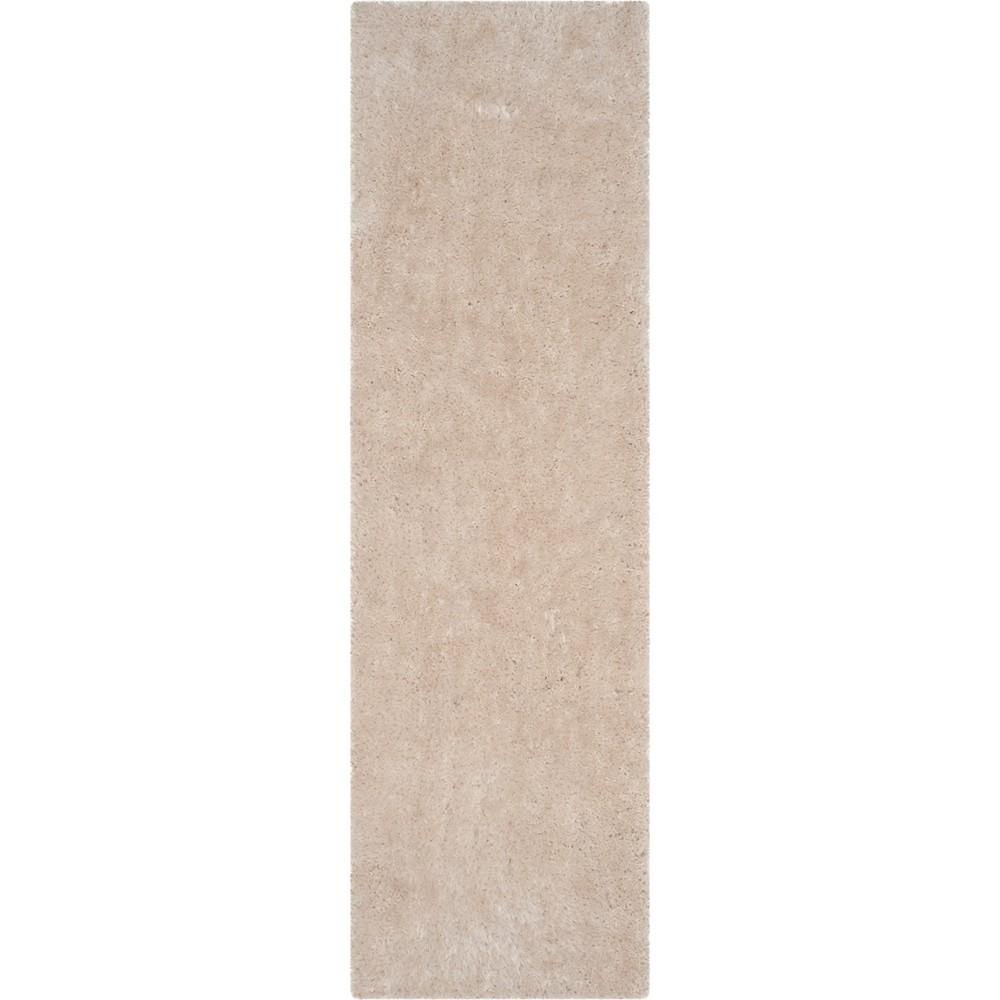 2'3X10' Solid Tufted Runner Bone/Light Gray (Ivory/Light Gray) - Safavieh