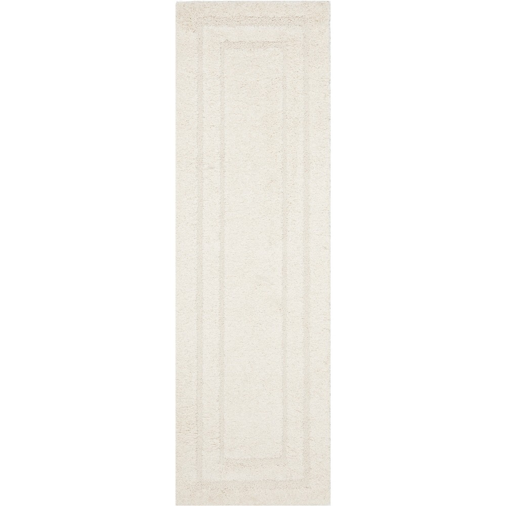 2'3X10' Solid Loomed Runner Cream (Ivory) - Safavieh