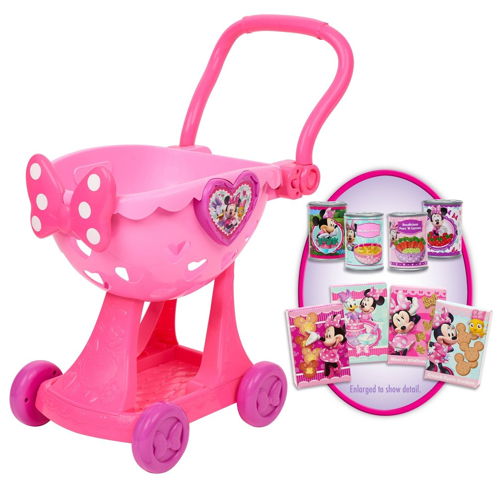 Disney Minnie's Happy Helpers Bowtique Shopping Cart Shopping with Minnie Mouse is so much fun! The Disney Junior Minnie's Happy Helpers Shopping Cart has all the fun Minnie-inspired details you know and love! The cart features a handle and wheels so kids can pretend to roll through the store and purchase a variety of bowriffic food items from play cans to Minnie pretend treat boxes. Perfect for a shopping adventure! Ages 3+ Gender: Unisex.