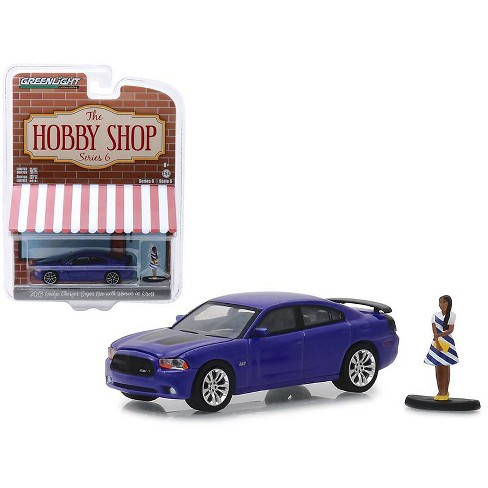 "2013 Dodge Charger Super Bee Metallic Purple w/Woman in Dress Figure ""The Hobby Shop"" 1/64 Diecast Model by Greenlight - image 1 of 1"