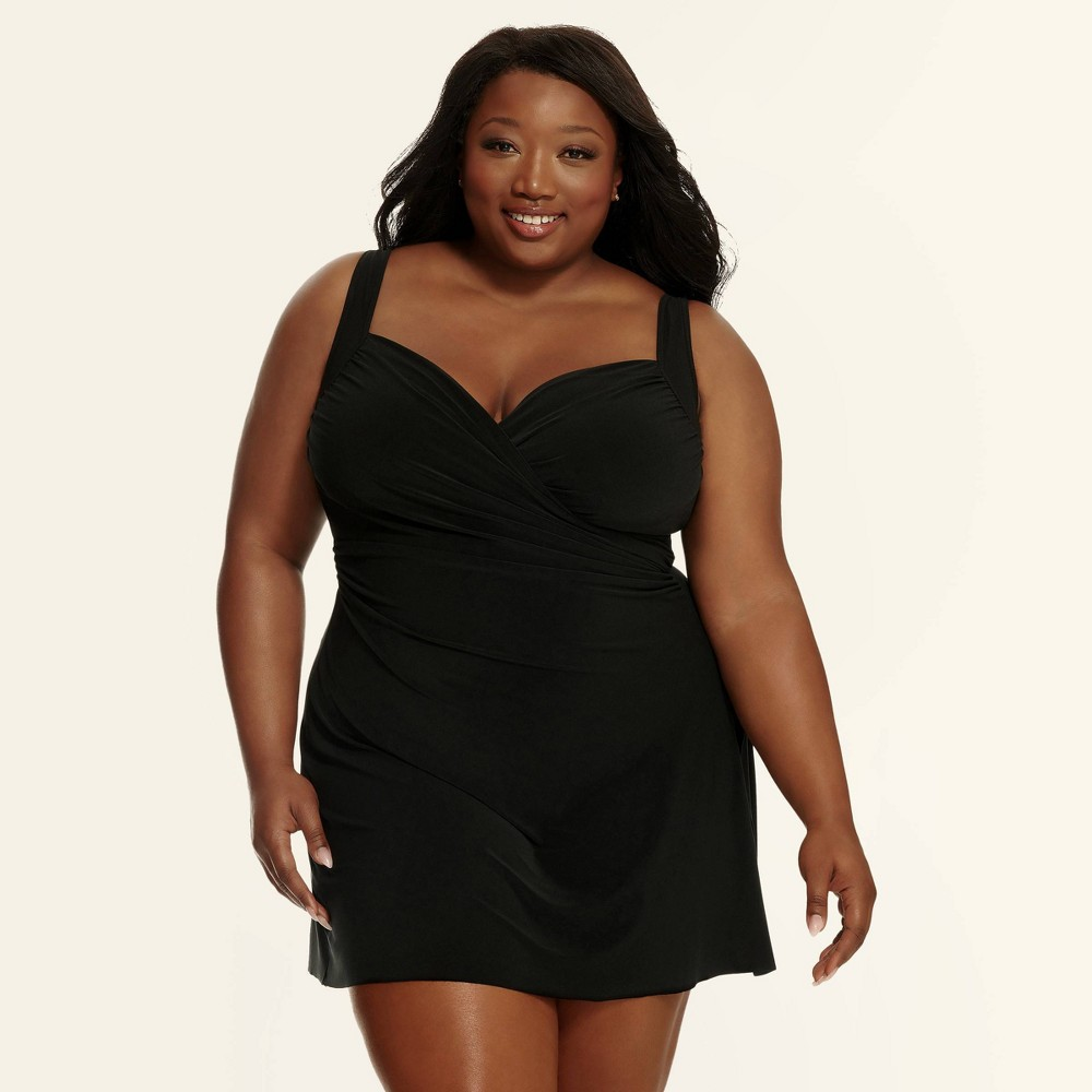 5df8f6006b2 In classic black, the faux wrap front whittles your waistline, while a  sweetheart neckline draws the eye upward.