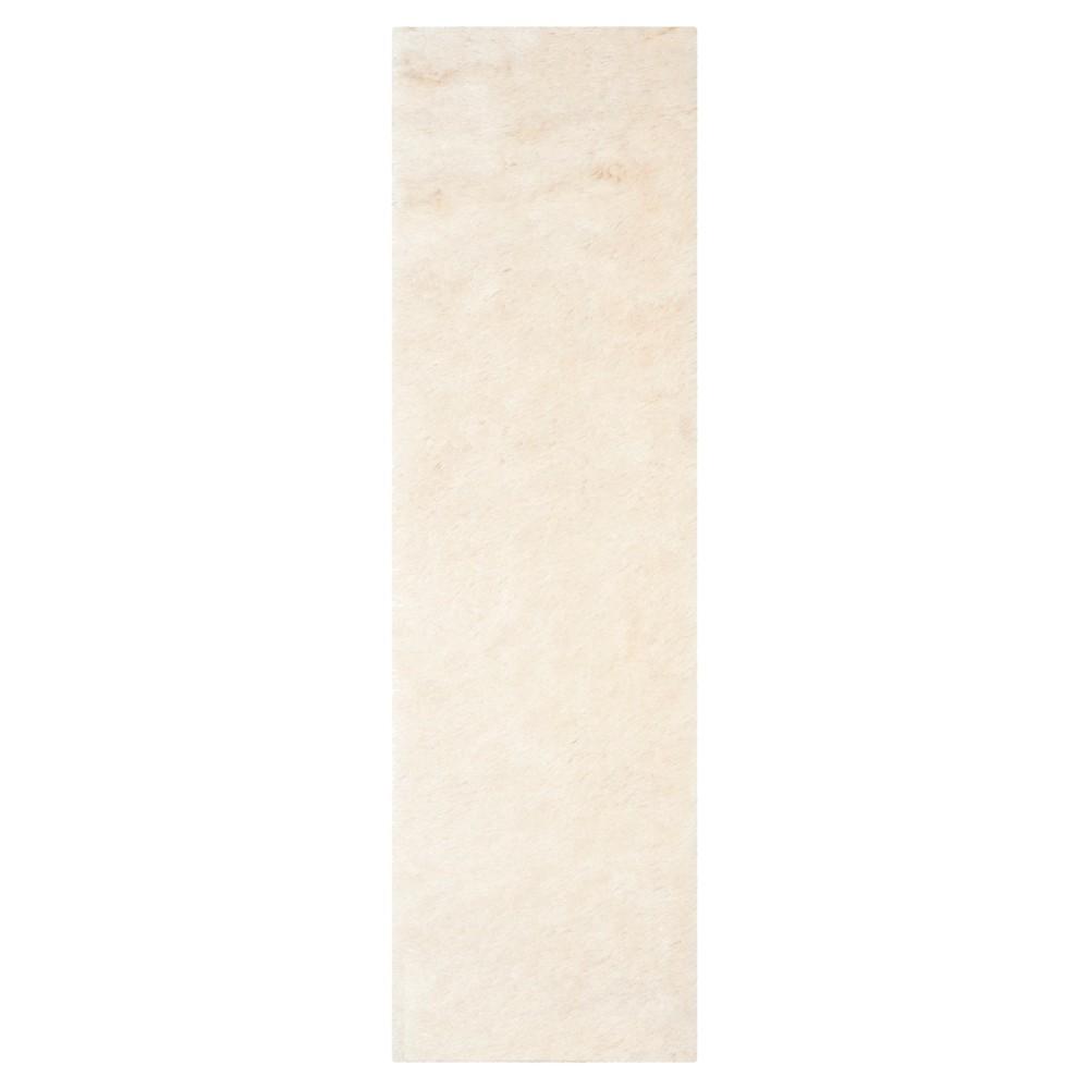 Ivory Solid Loomed Runner - (2'3X14' Runner) - Safavieh