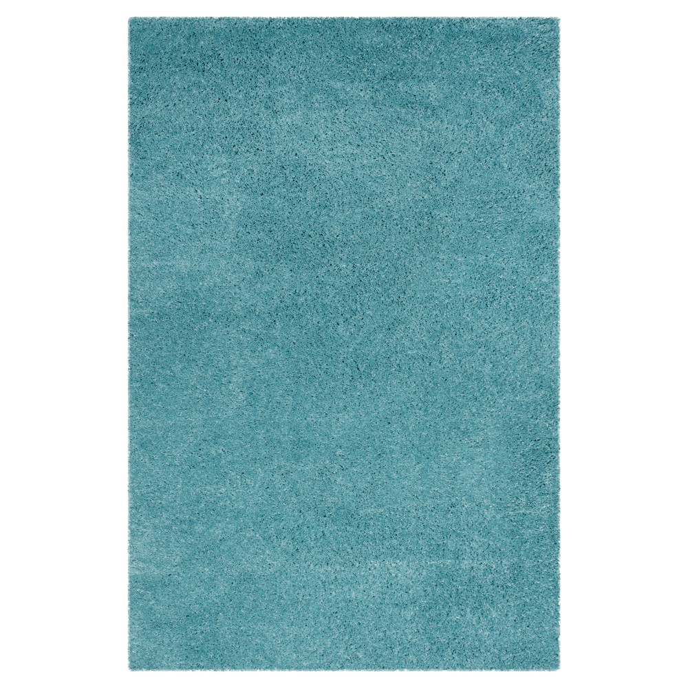 Turquoise Solid Hooked Area Rug - (6'7