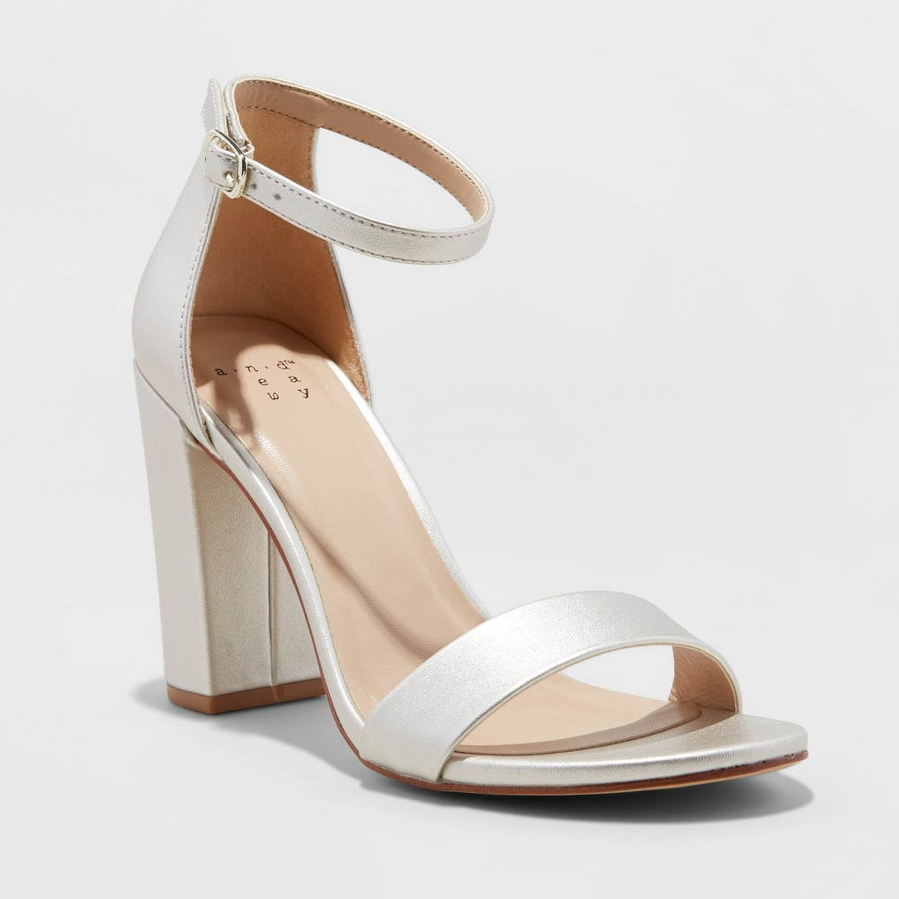 Elevate your warm weather wardrobe with ease with the Ema High Block Heel Pumps from A New Day™. This chic and charming pair of block heel sandals comes in a versatile neutral hue that\\\'s perfect for pairing with everything from a printed summer sundress to fitted little black dress to a pastel bridesmaid\\\'s dress. The 3.75-inch block heel provides some extra height with a sturdy, thick base that\\\'s easier to stand and walk on, and an adjustable ankle strap helps keep this block heel pump sandal firmly on your foot while you go about your day. Size: 8.5. Color: Champagne. Gender: female. Age Group: adult. Pattern: Solid. Material: satin.