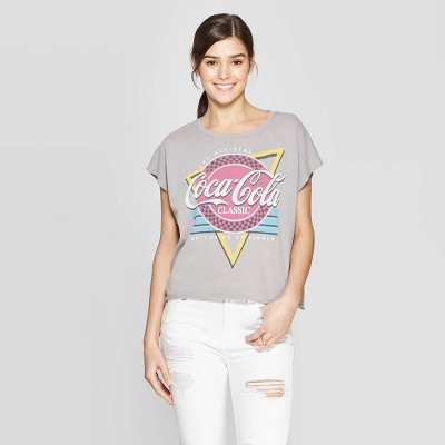 view Women's Coca-Cola Short Sleeve Classic T-Shirt (Juniors') - Gray/Red/Blue on target.com. Opens in a new tab.