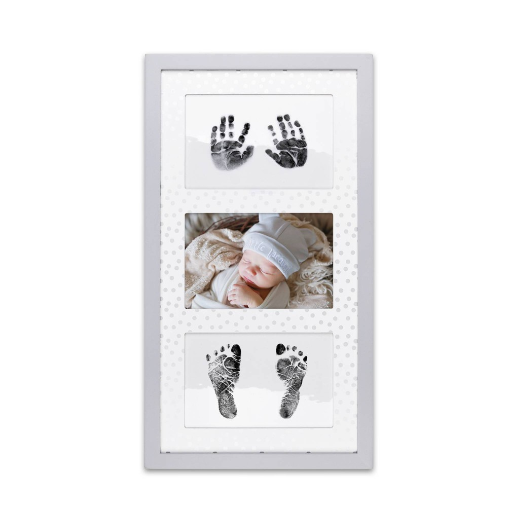 The Peanutshell Hand and Footprint Keepsake Frame Hold on to their little hands and feet forever with the Hand and Foot Keepsake Frame by The Peanutshell. Three cutouts in the gray confetti print mat provide space for hand / foot prints and photo. The frame includes 100percent baby-safe, inkless stamp pad that is clean and easy to use. Simply follow the instructions included to capture your baby's prints. Attached sawtooth hangers give you the flexibility to hang the frame vertically or horizontally. Makes the perfect shower gift for new parents or a keepsake for baby's nursery. Color: Gray White. Gender: unisex.