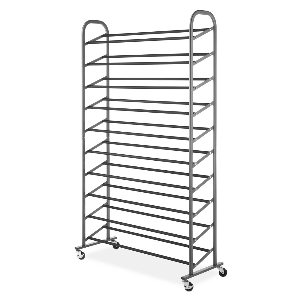 Shoe Rack Gunmetal - Room Essentials, Gray Keep your sandals, sneakers and heels off the floor and out of the entryway with this Gunmetal Shoe Rack from Room Essentials. Featuring a durable steel construction, this vertical shoe rack features a double bar design to accommodate different styles of shoes, while smooth-glide caster wheels make it easy to move from one place to another. The perfect storage solution for men's, women's and kids shoes, this steel shoe rack looks great with any decor, whether you place it inside a large closet or in your entryway. Color: Gray.