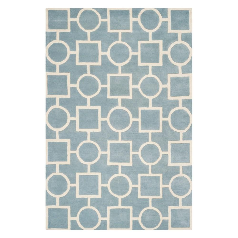 8'9X12' Geometric Tufted Area Rug Blue/Ivory - Safavieh