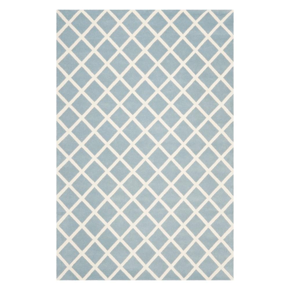6'X9' Geometric Tufted Area Rug Blue/Ivory - Safavieh