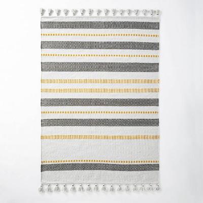 5' x 7' Indoor/Outdoor Multi Stripe Tassel Area Rug Gold/Gray - Hearth & Hand™ with Magnolia