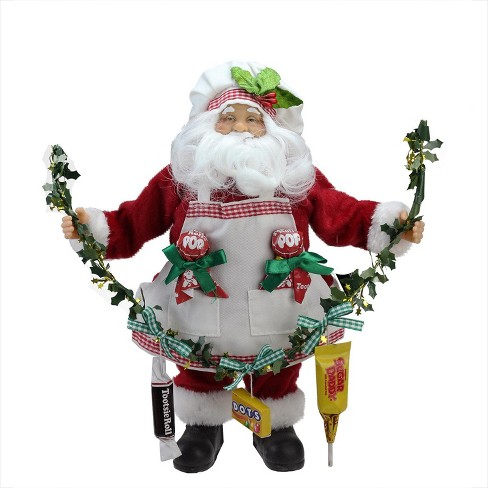 "Northlight 12"" Santa Claus Holding a Garland with Tootsie Candies Christmas Decoration - image 1 of 4"