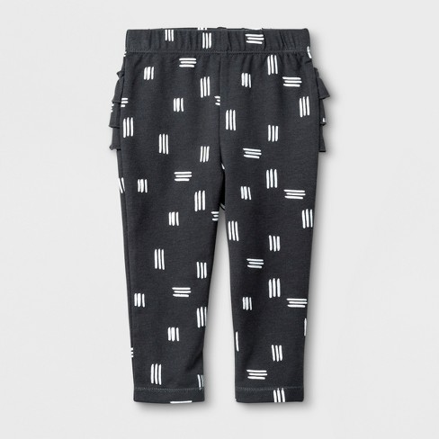 Baby Girls' Leggings with Shapes Print and Bottom Ruffles - Cat & Jack™ Black/White - image 1 of 2