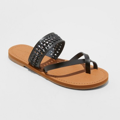 view Women's Taryn Woven Toe Ring Sandals - Universal Thread on target.com. Opens in a new tab.