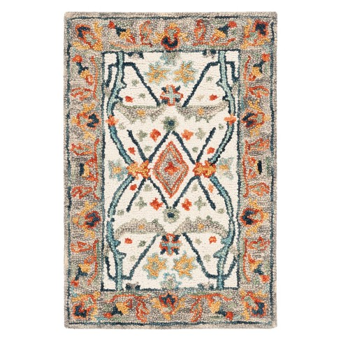 Joan Floral Tufted Accent Rug - Safavieh - image 1 of 3