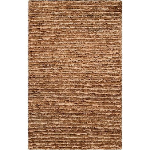 Kathie Solid Knotted Rug - Safavieh - image 1 of 3