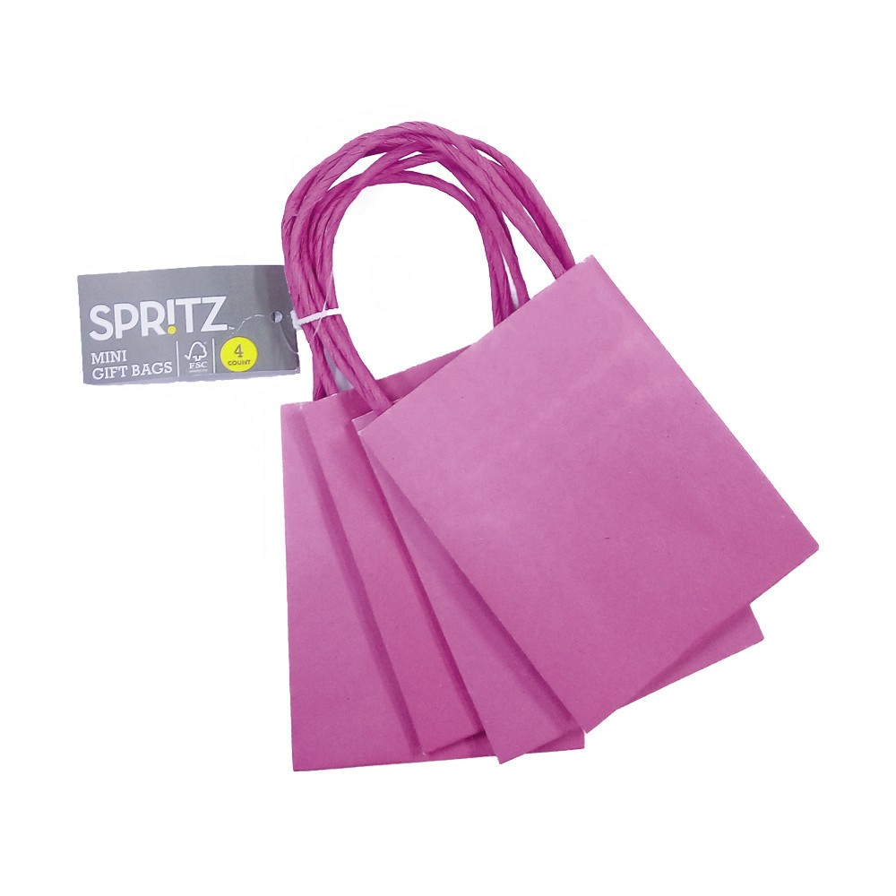 4ct Mini Bags Pink - Spritz Give your gift-giving skills a savvy update with these 4-Count Pink Mini Bags from Spritz. Crafted in sweet, sassy pink, these eye-catching mini gift bags are ideal for holding small gifts like sweet collectibles, perfumes, ties or scarves. Dress up your gift with a sheet of complementary tissue for a fine finishing touch or tie a patterned ribbon to the matching handles for extra glamor. Add a gift tag of your choice to carry a personal greeting.