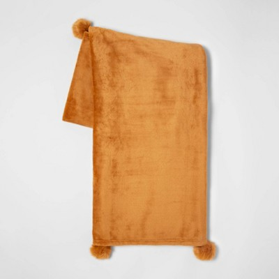 Solid Plush with Faux Fur Poms Throw Blanket Gold - Opalhouse™