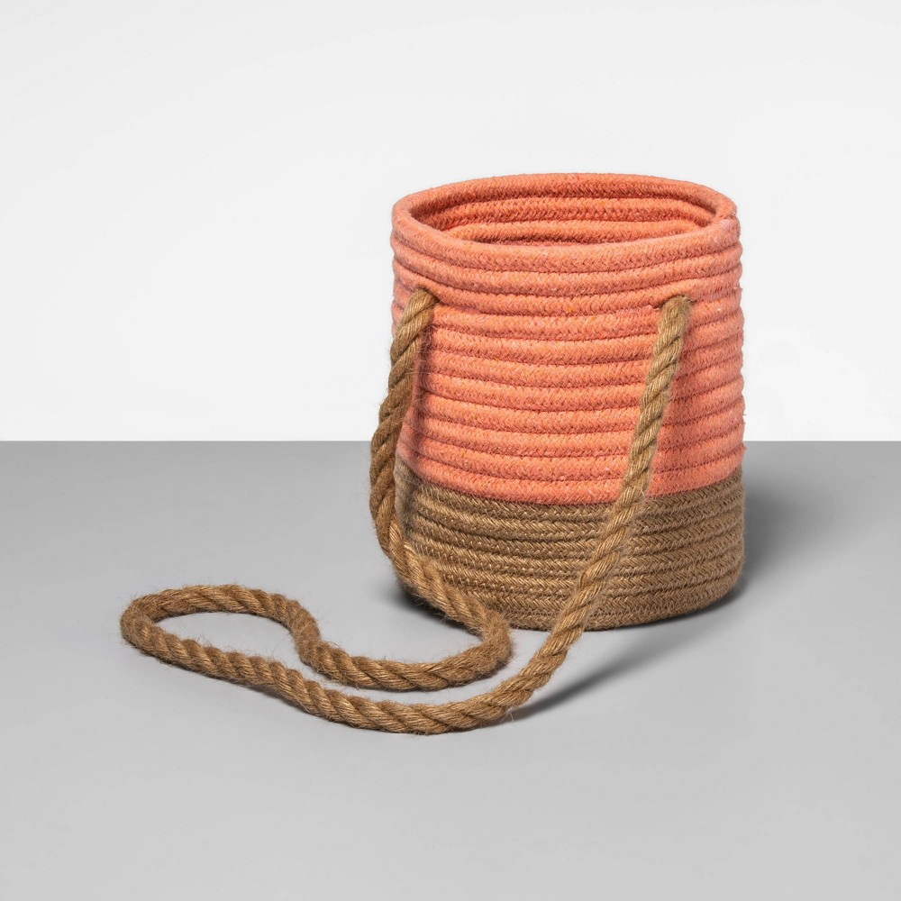 Add a new flair to your storage with this coral Coiled Rope Basket from Opalhouse?. This decorative basket makes a practical addition to organize any room and will provide years of durable use in your home. Featuring a two-tone coiled construction, it brings a nice hint of texture and stylish design. This round-shaped basket can be used for storage purposes, as an attractive accent or as a hanging planter for your fresh greens. Finished with a rope handle for easy mobility around your home it can be placed in any room for versatile use. This is your house. Where you create spaces as bold as your spirit. Collect objects as inspired as your dreams. Find pieces that remind you of every place you?ve been. Discover stories to inspire everywhere you have yet to go. This is Opalhouse.