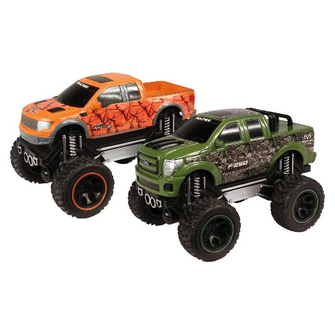 NKOK RealTree - Push 'N Go Trucks - Ford F-150 SVT Raptor & Ford F-250 Super Duty 2-Pk - 1:24 Scale - image 1 of 2