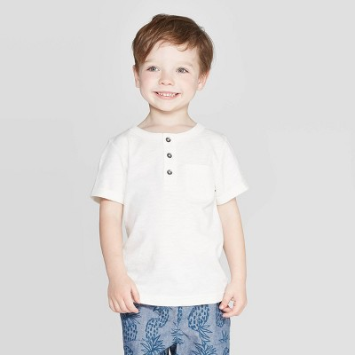 view Toddler Boys' Slub Jersey Henley Shirt - Cat & Jack Cream on target.com. Opens in a new tab.