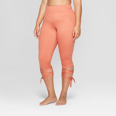8e522a9b928 Women s Plus Size Side Tie Mid-Rise Capri Leggings - JoyLab™ Cognac ...