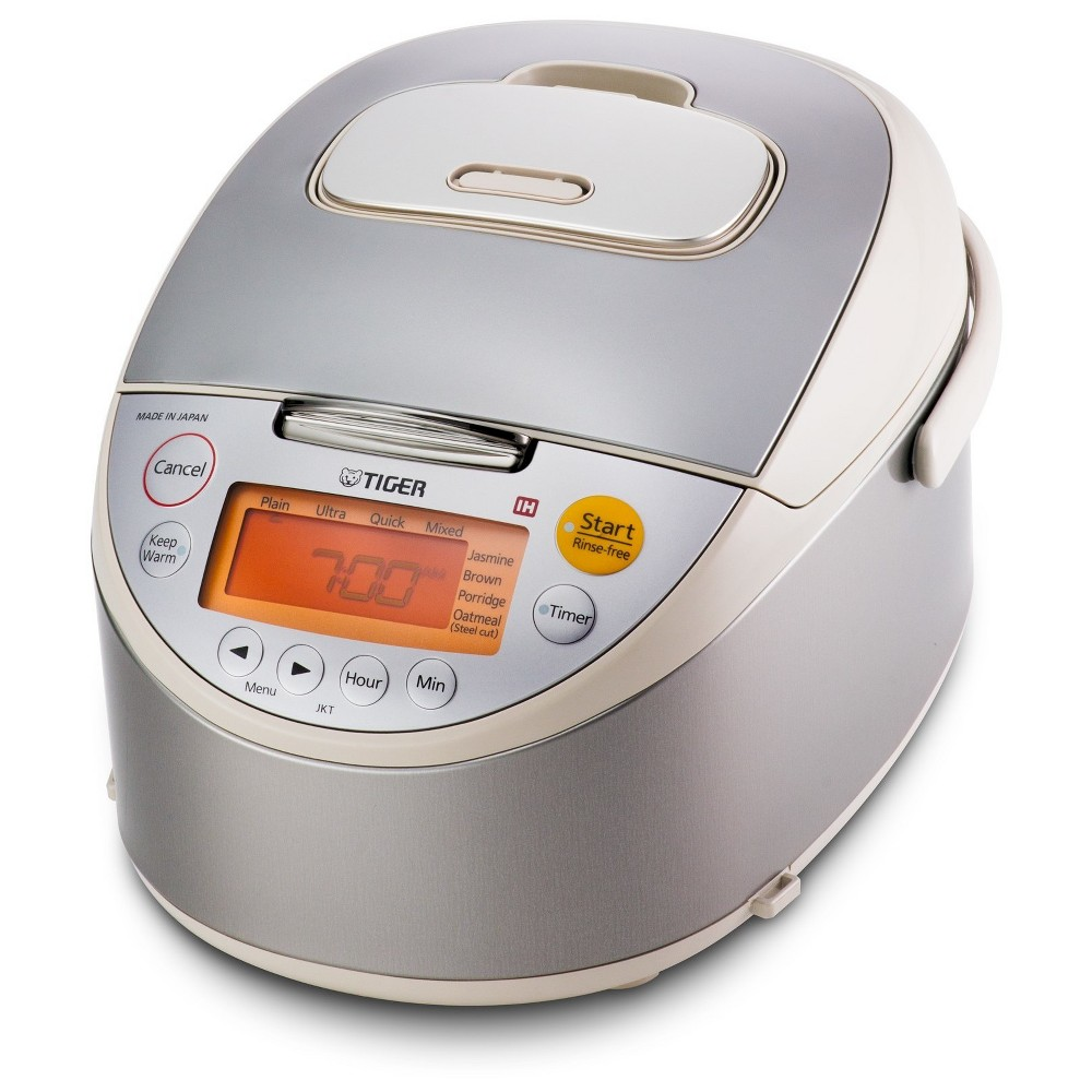 Tiger 5.5 Cup Induction Heating Rice Cooker, Beige Complement your meals with delicious rice using this Tiger 5.5-Cup Induction Heating Rice Cooker. Compact and convenient, this rice cooker boasts a capacity of five cups, making it ideal for both small and large families. Featuring a sturdy construction in metal and stainless steel, this rice cooker and warmer allows you to cook the perfect rice in a short amount of time. Designed with a variety of settings to accommodate different kinds of rice, you can even prepare your morning breakfast meal with the one-touch oatmeal setting. A durable, non-stick inner pan ensures that every grain of rice is evenly cooked and delicious, while the smart  keep warm  function maintains optimum freshness and serving temperature. Whether it's your quick breakfast or dinner meals, this multitasking rice cooker makes a great addition to your kitchen. Color: Beige.