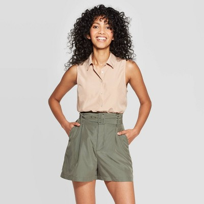 view Women's Sleeveless Collared Button-Down Shirt - A New Day Beige on target.com. Opens in a new tab.