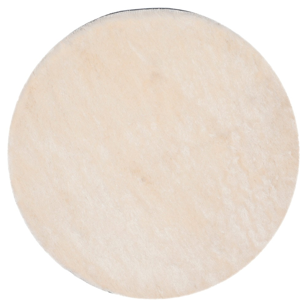 Ivory Solid Loomed Round Area Rug - (9' Round) - Safavieh