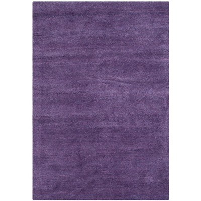 Mandy Solid Tufted Rug - Safavieh