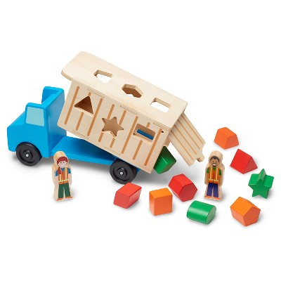Melissa & Doug® Shape-Sorting Wooden Dump Truck Toy With 9 Colorful Shapes and 2 Play Figures