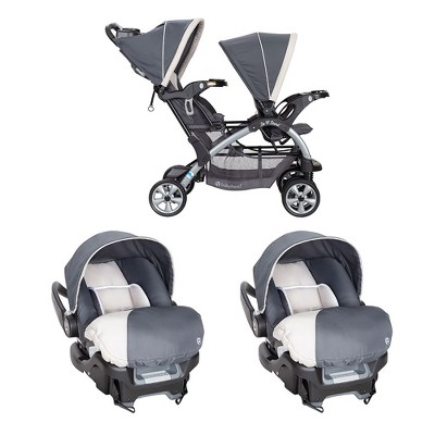 Baby Trend Sit N' Stand Double Stroller and 2 Infant Car Seats Combo, Magnolia