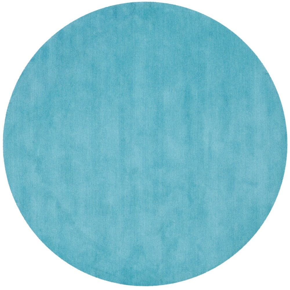 6' Solid Tufted Round Area Rug Turquoise - Safavieh