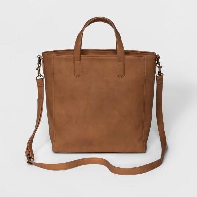 view Rowan Small Tote Handbag - Universal Thread on target.com. Opens in a new tab.