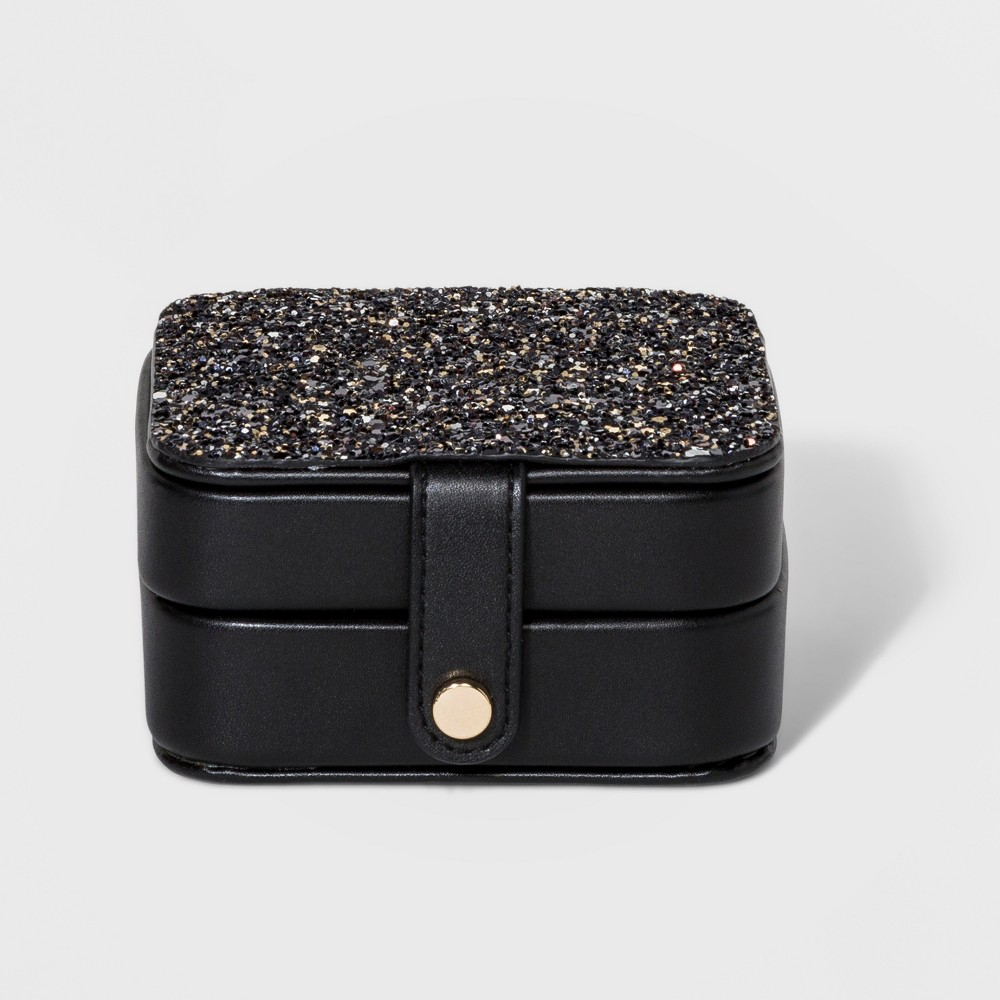 Jewelry Case with Interior Jewelry Organizer - A New Day Black Glitter Women's jewelry case with PU tab closure. It has a large tray with 3 necklace hooks in top compartment and 4 small trays with 6 ring holders in bottom compartment. Case is great for carrying small jewelry (rings, necklace, etc) when travel and it can be storage the accessories easily. Color: Black Glitter. Gender: Female.