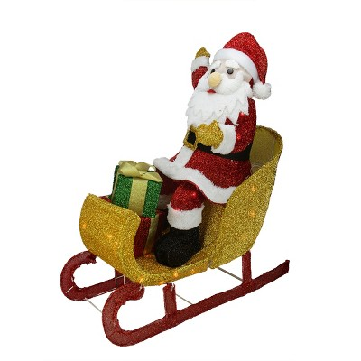 """Northlight 29.5"""" Red and White Santa Claus in Sleigh with Gift Box Christmas Outdoor Decor"""