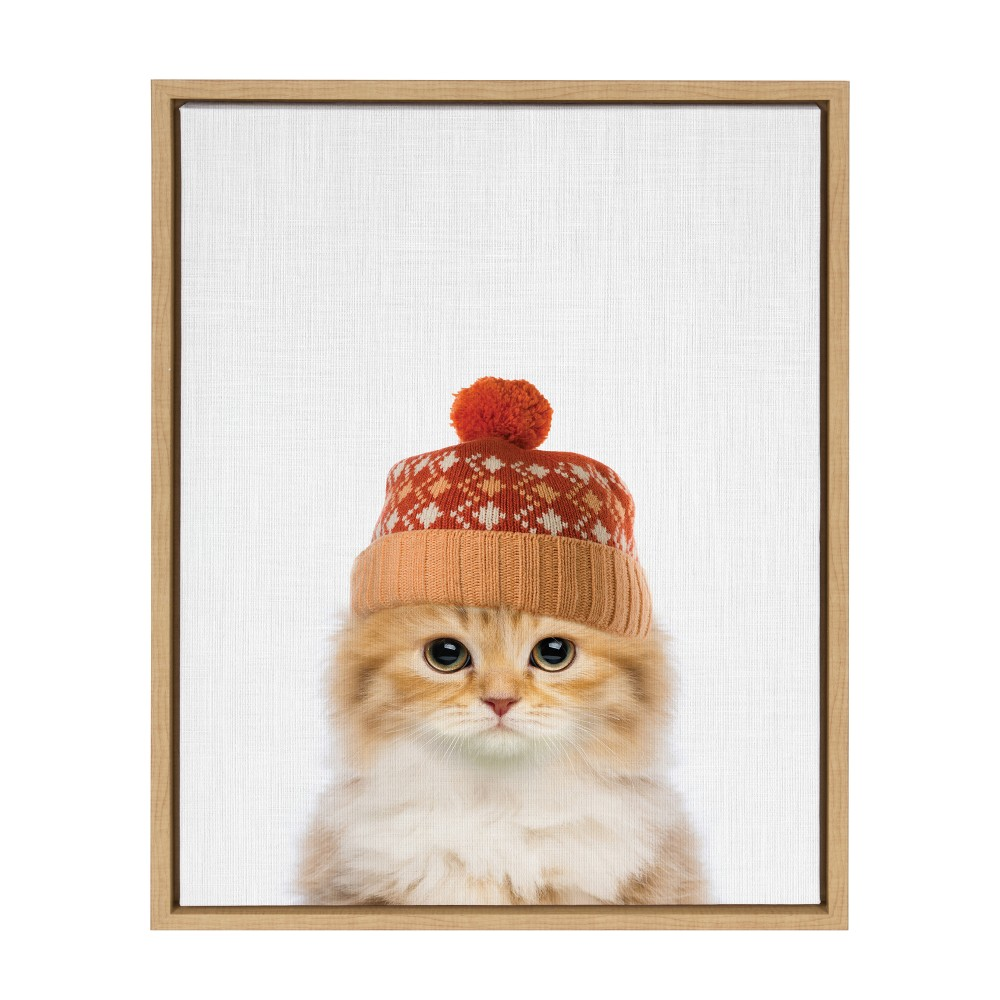 "Image of ""Kate & Laurel 24""""x18"""" Sylvie Orange And Tabby Cat Wearing Winter Knit Hat Photograph Framed Wall Canvas Wood"""