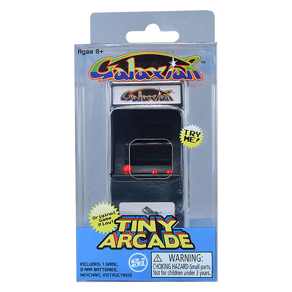 Tiny Arcade - Galaxian, Electronic Games Officially licensed miniature replica of the vintage original Galaxian video arcade game. It's tiny and measures overall at less than 4x2x2 inches with a 1 1/2x1 inch screen. The play is big for the small size. Fully functional, authentic game play Galaxian! Full color, hi-resolution graphics. Authentic game sounds. Light up header. Gender: Unisex.