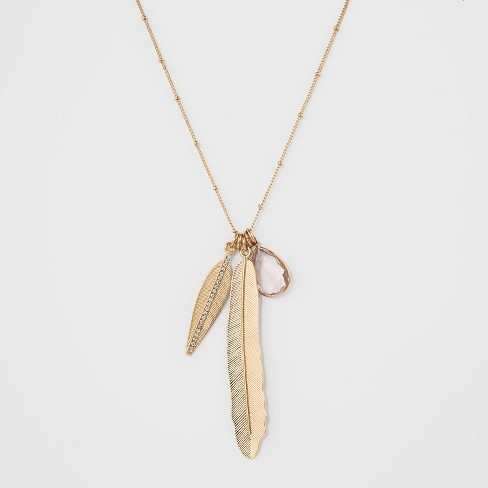 "Women's Long Cluster Pendant Necklace with Feather, Leaf, & Simulated Jewel - Clear/Gold (36"") - image 1 of 3"