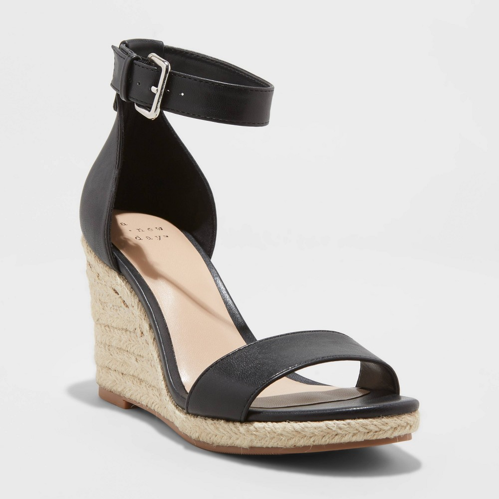 From an off-duty look to an outfit for date night, the Lola Ankle Strap Espadrille Wedge from A New Day™ gives you ample styling options. Featuring a smooth faux-leather upper with a textured outsole, these faux-leather wedge sandals add a little oomph to any outfit you pair them with. Plus, you\'ll love the wedge heels that offer a more stable platform, and the heeled back secured with adjustable ankle straps that keeps the shoes securely in place. Pair these faux-leather ankle strap wedges with a biker jacket and skinny jeans for the perfect off-duty look, or with a printed blouse and dress pants for a polished twist. Size: 11. Color: Black. Gender: female. Age Group: adult. Pattern: Solid.