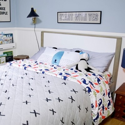 A bed made with Pillowfort bedding