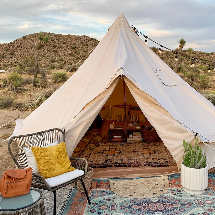 Photo of Olivia's tent and outdoor patio seating.