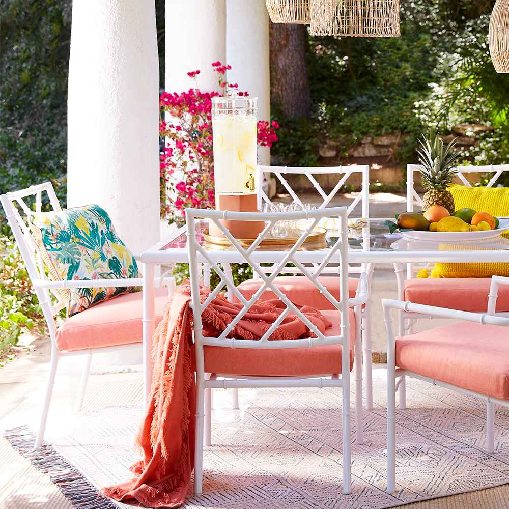 Create a bright inviting dining space with bohemian inspired tableware layered with natural elements.