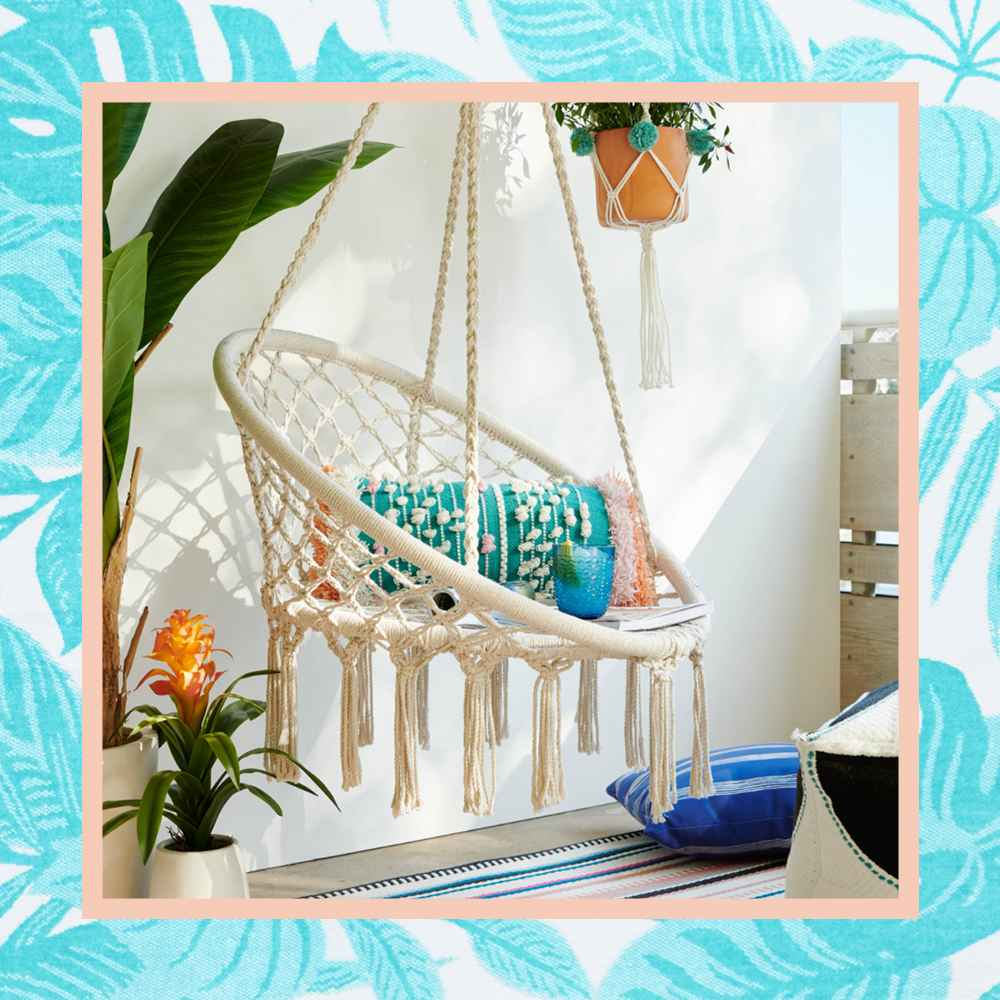 """Hanging Rope Chair Off White - Sorbus, Textured Stripe Throw Pillow - Opalhouse™, Faux Flower Plant in Pot White/Green - Opalhouse™, 72"""" Banana Tree in Cement Pot  - Opalhouse™, Large Handmade Novelty Macrame Plant Hanger with Poms Cream - Opalhouse™, Pouf Arc Black/White - Project 62™, 8"""" Embossed Planter Terracotta - Project 62™, 5' x 7' Outdoor Rug Multi Stripe Global Pink - Opalhouse™"""